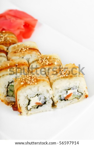 Sushi rolls at plate isolated on a white - stock photo