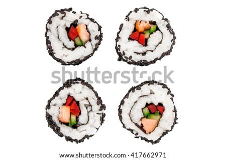 Sushi rolls - close up image of uramaki sushi covered with black sesame seeds. - stock photo