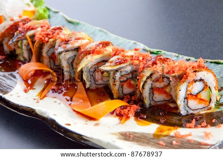 Sushi rolls on a plate. - stock photo