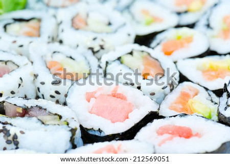 Sushi rolls on a plate from above. Shallow DOF - stock photo