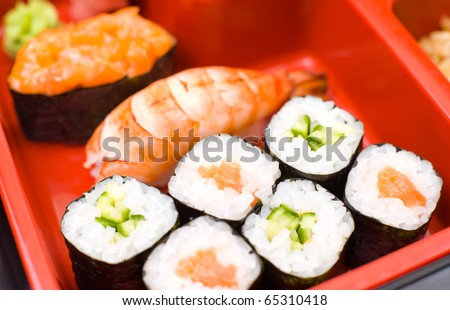 sushi rolls on a traditional oriental sectioned dish