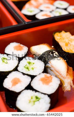 sushi rolls on a traditional oriental sectioned dish - stock photo