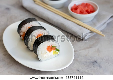 Sushi rolls on white plate on gray table. Traditional Asian food. Diet healthy food.Top view. Horizontal - stock photo