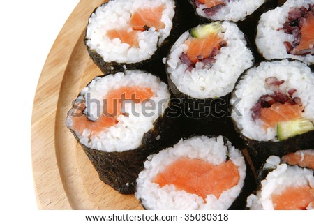 sushi rolls on wooden plate over white