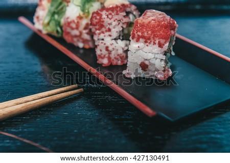 Sushi rolls with chopsticks - stock photo