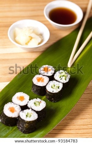 Sushi rolls with chopsticks