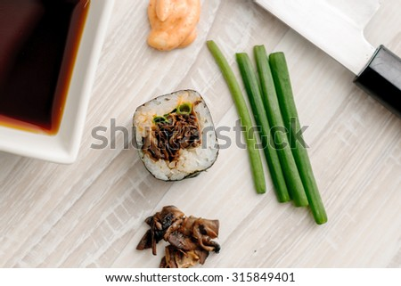 sushi rolls with ingredients on the wooden board - stock photo