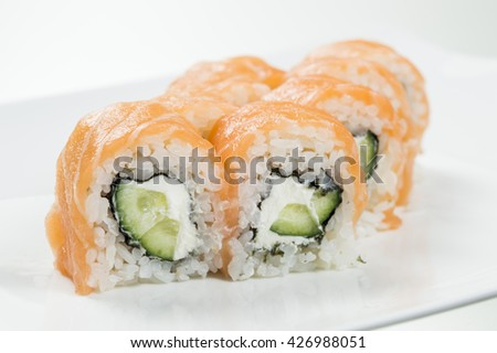 Sushi rolls with salmon and cucumbers in the middle