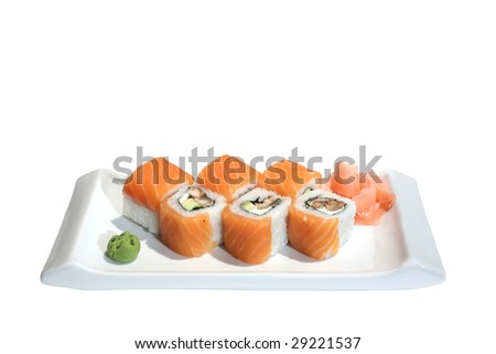 Sushi (rolls) with salmon, eel and avocado on a plate, wasabi, marinated ginger. Isolated on white