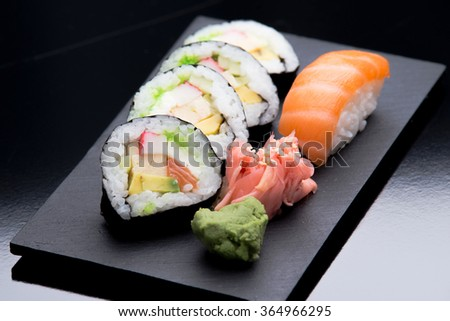 Sushi served on plate, slate. Nigiri, maki. - stock photo