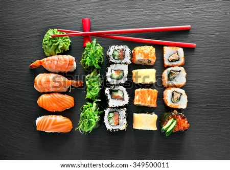 Sushi set and chopsticks on a slate table - stock photo