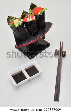 Sushi set funnel tree piece with sauce chopstick, vertical - stock photo