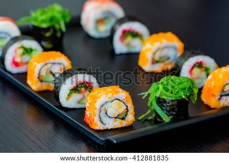 Sushi Set in black dish - stock photo