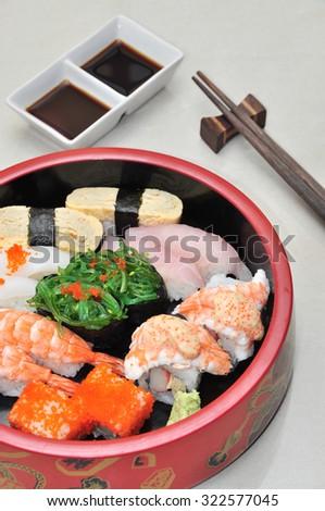 Sushi set in circle bowl - stock photo