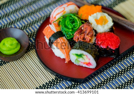 Sushi Set in Japanese dish with shoyu Sauce and wasabi - stock photo