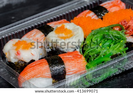 Sushi Set in plastic box - stock photo
