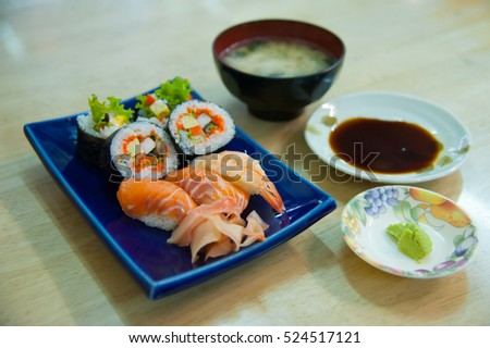 Sushi set Japanese food with side dish on wooden table at home
