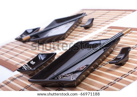 Sushi set of cups and chopstick isolated on white. Selective focus. - stock photo