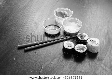 Sushi set on a black - stock photo