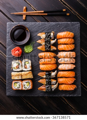 Sushi Set on black stone slate background - stock photo
