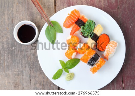 Sushi set on wooden background - stock photo