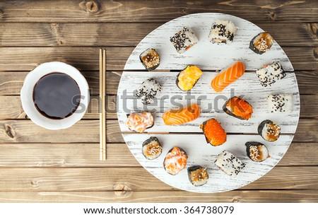 Sushi set on wooden background. - stock photo