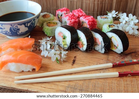 Sushi set on wooden desk with soy sauce - stock photo