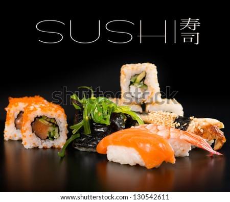 Sushi set  over black - stock photo
