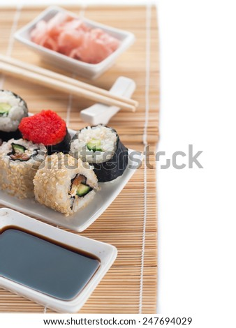 Sushi set served on white background, selective focus