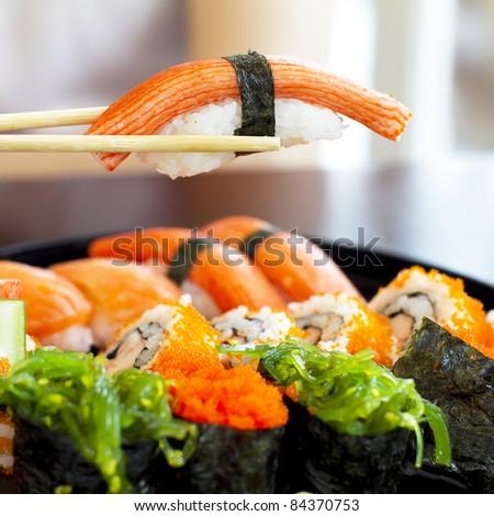 sushi set with chopstick over the sushi set - stock photo