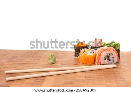 Sushi set with wasabi and chopstick on plate with White Isolated background.  - stock photo