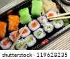 Sushi specialties and chopsticks - stock photo