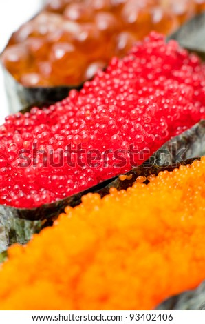 sushi stuffed with different kinds of caviar, macro - stock photo
