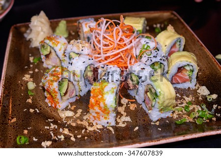 Sushi typical Japanese food served on a plate in a restaurant                               - stock photo