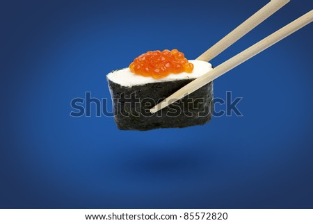 Sushi with caviar is isolated on a blue background
