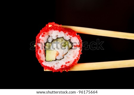 Sushi with chopsticks - stock photo