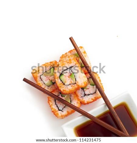 Sushi with chopsticks isolated over white background - stock photo