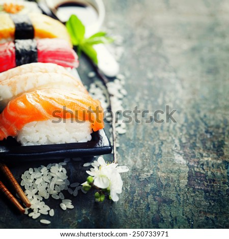 sushi with chopsticks on old  wooden background - stock photo