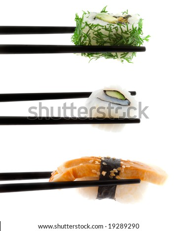 Sushi with chopsticks shot on white - stock photo