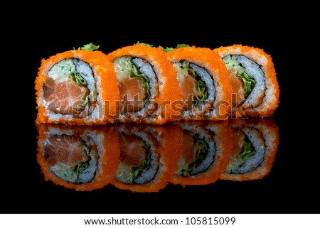 Sushi with flying fish eggs glass reflection stock photo for Flying fish egg