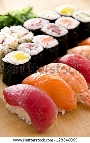 sushi with rolls on the plate - stock photo