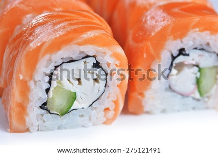 sushi with salmon and avocado on plate - stock photo