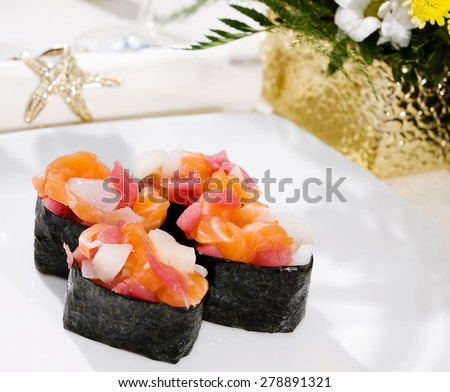 Sushi with salmon, tuna and scallop and spicy sauce in nori on a white background close up isolated - stock photo