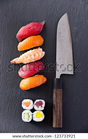 sushi with santoku knife - stock photo