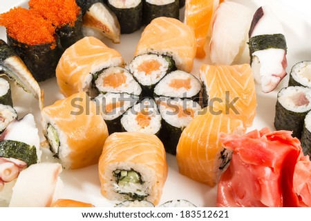 sushi with seafood and vegetables on a white background in the restaurant