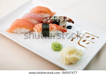 Sushi with shrimp, tuna, trout, eel and smoked salmon - stock photo