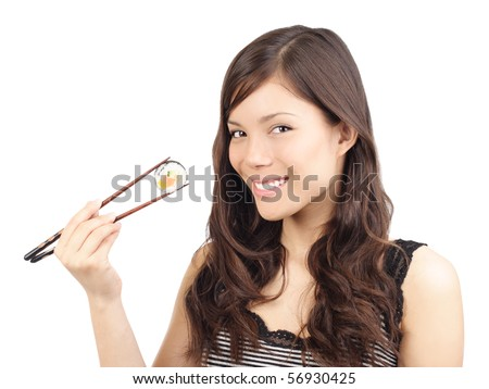 Sushi woman holding sushi with chopsticks looking at the camera smiling. Isolated on white background, Asian / Caucasian model.