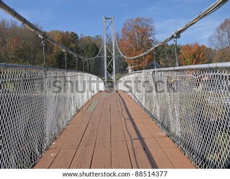 Suspended pedestrian bridge - stock photo