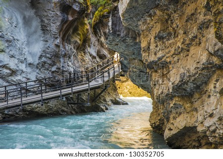 Suspended walkway above Johnston Creek, Banff National Park, Canada - stock photo
