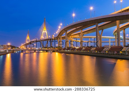 Suspension Bridge across the river at twilight, The Industrail Ring Road (Bangkok, Thailand) - stock photo